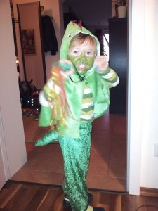 In his right had Lukey holds a green tube lovingly tacked to nylon ribbons to suggest a fire-breathing dragon